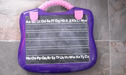Chalkboard with guiding lines for learning handwriting. Other side is magnetic doodle board with magnetic pen. Very effective tool! See my seller's list for other kids' items.