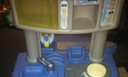 2 sides (opens up so you can use it in a corner, or along a wall, etc or use folded together). One side has oven, stove, sink Other side is ironing board, washer, dryer Comes with iron, and some accessories. Makes sounds Very sturdy This ad was posted