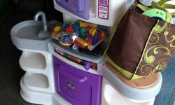 Little Tykes Kitchen plus toy dishes. also includes some wooden blocks.