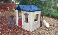 little Tyke Play house . Awesome for inside or outside.