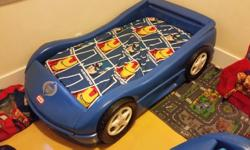 I have for sale 2 Little Tykes blue race car beds for sale. Both come with the mattresses and are in perfect condition. Decepticon logos included!!!! $100.00 each OBO