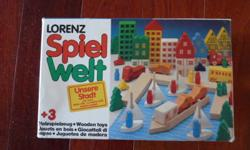 Beautiful Wooden toy made in West Germany.  Stimulates the imagination of young minds.  It is rated for 3-year-olds and over.  The set consists of 65 wooden pieces (a complete set).  The pieces are made from durable hardwood, painted with highly polished