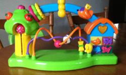 Three 6 to 12 months toys. Like new condition. 1. Activity board: buttons with music and animal sounds, rings, beads, etc. (my son enjoyed it up until around 18 mths) - Batteries included. 2. Wheel with suction cup and toys to spin: bird, sun, mirror and