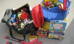 """Includes Collapsible Toy Bag, and long Red Hanging Toy storage """"basket"""", TMNT Hummer, Rescue Hero Police Car, Kinnex & Kids Kinnex, 2 small hockey Sticks, Large box of crayola crayons and twist able pencil crayons + lots of small toys, odds and ends..."""