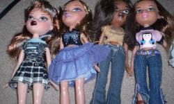 eight bratz dolls with clothes and assesories