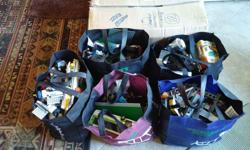 approx. 35 lbs in this tub which is 27 long 18 wide 13 deep, the tub plus a picture shows some built and partially built units. came in 5 cloth bags as shown, there are lots of people mixed in. not too old, boxes are empty. this is a large lot so the