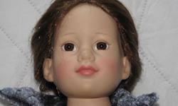 *Reduced* This is a beautiful 18 inch Doll with outfits from 2003 made by Tonner Doll Company. This doll line is now discontinued. She has soft rooted hair and a hard body and legs. She has been gently played with, but has no marks or rips or stains. A