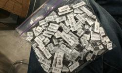 Ziplock bag filled with magnetic words. Its the jumbo basic set (or something like that). We've had lots of fun with it over the years but small children do not mix well with small magnetic objects.