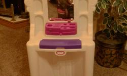 MAKE-UP TABLE AND STOOL Little Tikes Make-up table with lights that really light up. Also has speaking modes. Tray for lipstick, nail polish, comb, make-up brushes, etc. Other side has full length mirror, 2 clothes hooks and shoe compartment. Uses 3 AA