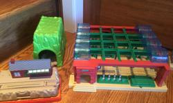 Heaps of buildings, including Knapford station, Tidsmouth Sheds, a Ferris Wheel, cranky the crane, jeremy and his hangar, 2 tunnels, multiple bridges and risers and soooo much more. See pics. Huge box of just tracks and accessories, multiple sizes for