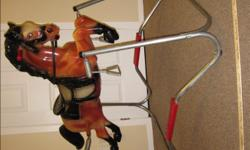 """Mattel Spring Horse - Durable and in excellent condition - Eyes move up and down - Has reins - MP brand on horse's rump - Step-up to mount into saddle - Wooden bar and metal stirrup option - Measurements: Horse - length = 38"""" and height = 24"""" Frame -"""