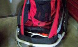 MEC Double Jogging Stroller and Bike Trailer.  Excellent condition (except for tiny tear in mesh/bug screen, which could easily be stitched) Always stored inside, never left outside.  The trailer attaches securely in seconds, and releases easily too. If