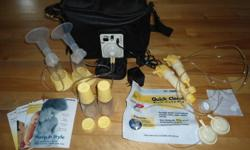 Medela Pump in Style Breastpump for sale.  This pump offers portable convenience for quiet, discreet pumping anywhere. The On-the-go Tote features an integrated pump for portable convenience.   Includes: Stylish tote with built-in bottle holders and