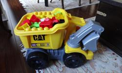 Mega Block Dump Truck With front loader with a lots of blocks smoke and pet free home very clean like brand new