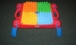 For sale is a Mega Blocks play table with most of the blocks it originally came with. This table has never been played with, but some of the blocks were taken out and used with another set. It's in like new condition, perfect for a Christmas gift as it's