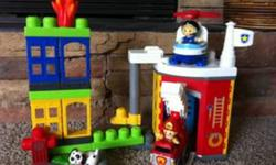 Mega Blocks Fire Station        includes fire truck, helicopter, fire fighter, rescue worker, dog, & more! Plus 200+ blocks, multiple colours (the large size building blocks). All in great condition!Pet free, smoke free home.