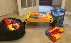 """A megablock building table, 2 megablock dump trucks (one small and one large), megablock John Deer car, over 300 pieces of megablocks and """"Paw Patrol"""" Ionix blocks which work with megablocks. In practically new condition! Would prefer to sell all"""