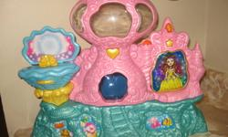 Mermaid Castle. By pressing a heart Music sounds, the stage inside of a pearl turns
