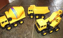 Cement mixer, dump truck, backhoe all with moveable parts, made of metal and plastic, all 8-10 inches long.