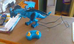 Rc dragon walks roars moves his head $40 at sears $20 to a new home
