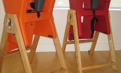 Exellent condition, two HiLo high chairs, one in carrot (orange), and the other in raspberry (red). Both have light wood legs. $160 each, or $280 for the pair. Solid construction, and very easy to clean. These are good looking enough you don't need to