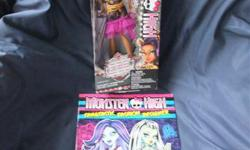 GREAT GIFT!!! Brand NEW, still in box. PLUS bonus brand new Monster High 2014 Fangtastic Fashion Designer book, stickers included. Great for collectors! Clawdeen Wolf, daughter of a werewolf. From the 2013 Frights! Camera, Action! Black Carpet collection.
