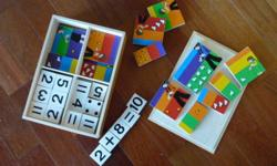 For sale, is a very beautiful wooden toy.  It has a variety of challenges for the early learner.  Counting and addition, matching colours and numbers.  You can see from the pictures the type of activities that are present in the toy. The box containing