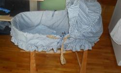 Moses basket with rocking stand, great condition other then the one handle shown in pic, could be easily fixed $35 OBO