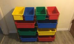 10 bin organizer Blue, Red, Green, and Yellow removable bins, light wood rack 4 rectangle smaller bins, 6 square larger bins See photos for details Very good condition