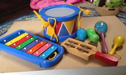 Lot of children's musical instruments, all in great shape and from a smoke-free home. Includes drum, xylophone, 2 maracas, tambourine shaker & 2 egg shakers Please note - found a crack in one of the green egg shakers pictures, so it is NOT included - only
