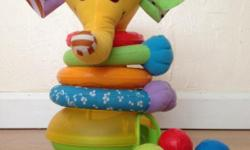 Colourful, musical elephant-shaped staking toy. When balls are dropped into cone, baby is rewarded with flashing lights and music! Balls double as shakers. Batteries included. Retails $40.