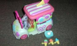 In excellent condition! Truck opens for your own Ice cream parlor! Ice cream attaches to pony leg. You can also fold the ponies leg so she can sit and drive the truck!