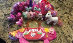 Lot of My Little Ponies in good used condition. Six large, 8 small and 3 carrying purses.