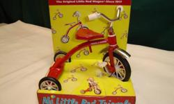 MY LITTLE RED TRICYCLE MODEL  905 Small little red tricycle is constructed with genuine radio flyer real working parts . this is a miniature. Measures 7 1/2 wide and stands 5 1/2 high inches. Located in Meadows West Inkster + Keewatin area. Phone 633-1471
