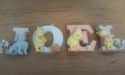 Beautiful ceramic?? letters for name. My son was given this as a present for a baby shower but we never did get around to putting it up in his baby room - too old now :) Brand new - never used letters for a baby, would make a wonderful baby shower gift or