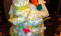 Want a perfect baby gift for the expecting mother, or baby shower gift. How about a diaper cake? Let me know what you want to spend and I can come up with something in your budget. Prices start at $40 and up