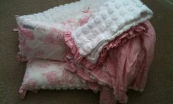New Arrivals Crib Bedding Set. Includes Crib Skirt with Pink Daisy Appliques, Chenille and Gingham Quilt and Chenille and Toile Bumper Pad. Paid over $250. Like new.