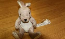 This bunny was bought at an Ikea. It is new and has the original tags on it. It is about 12 inches long.