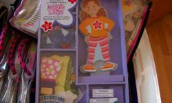 New items, store has closed and all must go.  This is wholesale pricing! Melissa and Doug Magnetic Dolls.  Maggie Leigh for Ages 3+ $8.00 SOLD Tops and Tights  (5 left) 2 Dolls with stands, clothes and accessories - $12.00 each .  Add gst   Emails will
