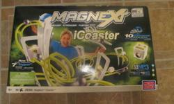 NEW IN BOXES please read list below would make great christmas presents   PICTURE 1 New in box Magnext Icoaster (build and play also plug and play you mp3 player not included) was $100 sell for $40 FIRM   PICTURE 2 New in box TP Digital game $10 firm