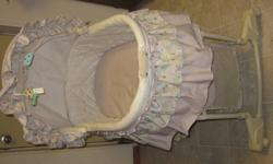 Bassinet for newborn-3 months old. Can be attached onto rocking base with added storage basket. Can also be detached and set on floor. Includes vibrating setting, night light and music. (Needs new batteries.) Two small hanging toys included. VERY lightly