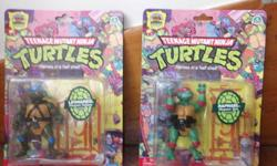 Teenage Mutant Ninja Turtles 25th Anniversary Action Figures. Minor creases on packaging. Good condition! Rare reproductions of the original TMNT toys! Asking $70 for the pair. OBO