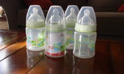 Various bottles, includes: 4 Nuk bottles - 1 brand new 1 Playtex drop in w/ 4 drop ins 3 Evenflo bottles - never used All for $10