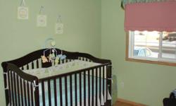 Set includes: Curtains with Valance and tie backs Crib sheet Comforter Crib skirt 2 pillows Bumper Pads 3 pictures Wall hanging Mobile Clothes basket From clean N/S home
