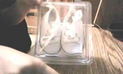 white in color and very cute shoes never worn , no use for them call 970-1396