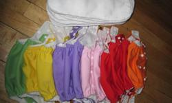 Adjustable from 8-28lbs, pocket diapers, 19 diapers, colors include orange, yellow, red, green, purple and pink.  I wore the pink on my son, who cares right?!  Comes with one insert each.  18 of the 19 diapers have had their elastics newly replaced, and