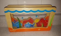 P'kolino fishing hole size sorter for babies. Match the color of the hole to the fish and drop in! The diving fish bounce on the base and create a drumming sound. Easily remove the fish through the open back. Six simple, playful fish shapes perfect for