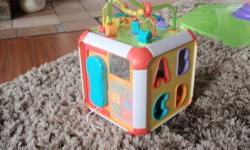 Activity Cube to keep kids busy Comes with block sorter (included) clock with opening door phone, with musical buttons keyboard