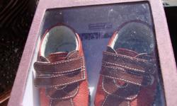 Cute Original Pediped pair of shoes. Never worn. Details at 30-40$ new + tax. Size is x-small (0-6 months) $20 or B.O.