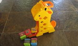 Giraffe with 5 animal blocks that tumble out of the giraffe making sounds.